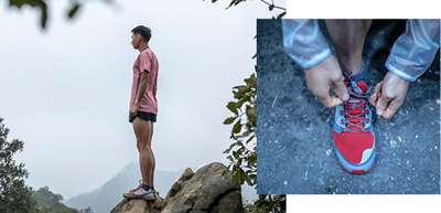 Columbia Montrail athlete Li Kuo standing on a rock.
