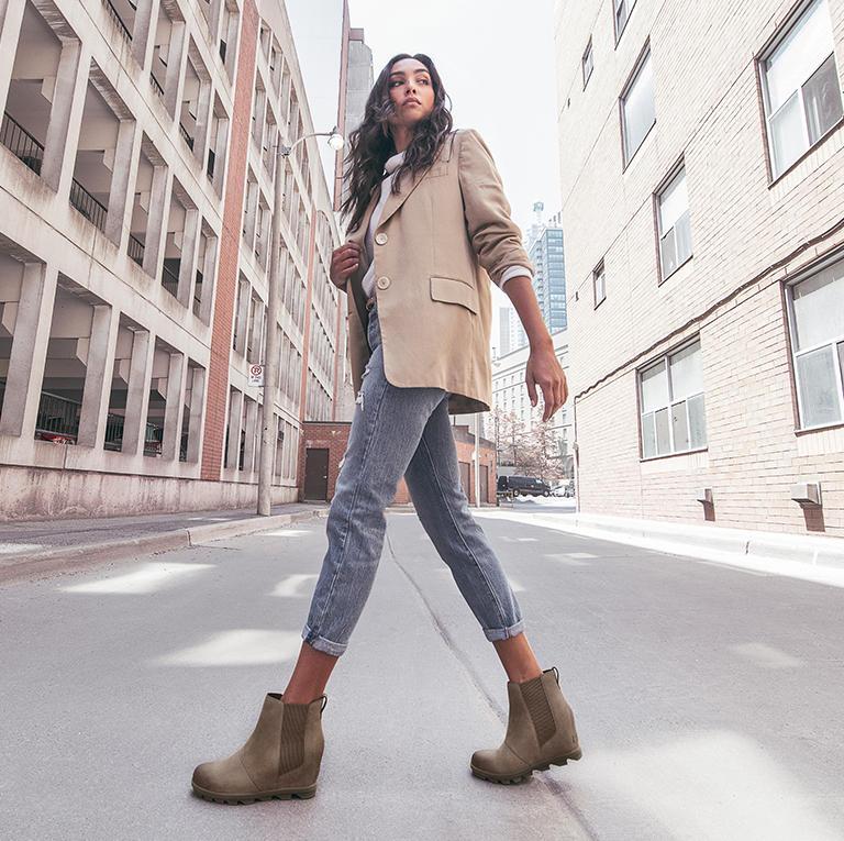 16a8c542e71b Walking walking through a city setting wearing a pair of JOA Wedge Chelsea  boots