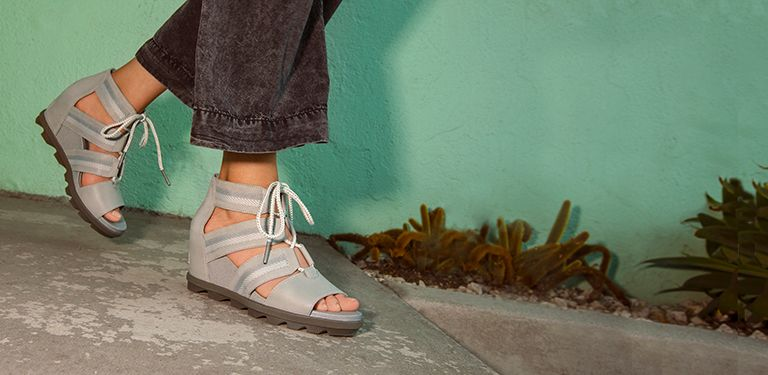 5a1775263 View of a woman s feet while wearing a pair of Joanie Lace Sandals in a  colorful