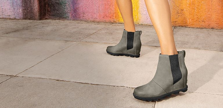 936e1408f75 View of a woman s legs while wearing a pair of Joan Wedge Chelsea boots in a