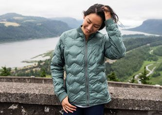A woman in a Columbia insulated mid layer.