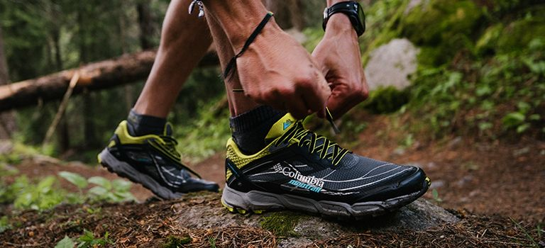 Trail running shoes on forest path.