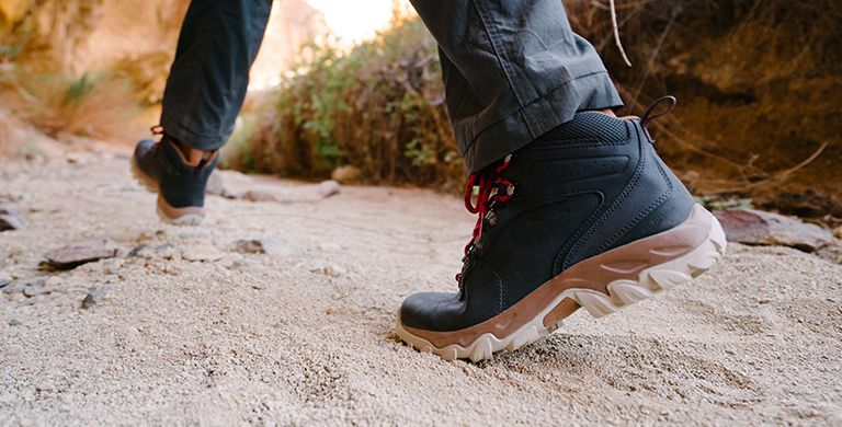 A man wearing wide hiking boots.
