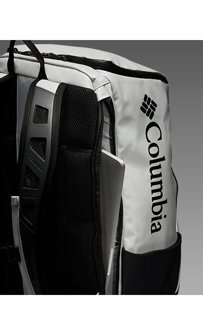 A close-up of a pack with a computer in the sleeve.