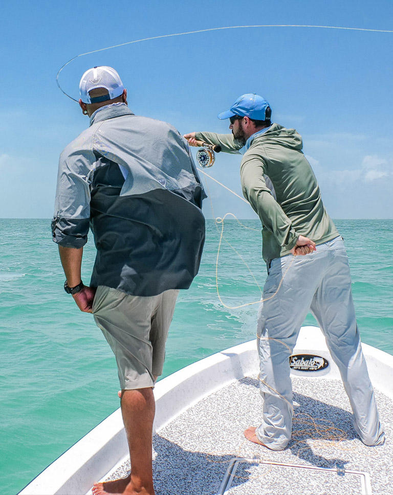Badfish TV's Marty Gillipeau casts from a boat in Belize while wearing Columbia PFG.