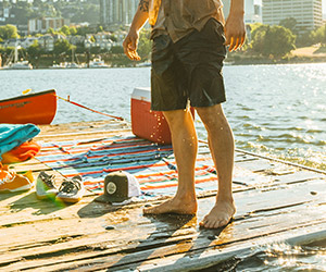 Close-up of a man wearing Columbia shorts on a dock