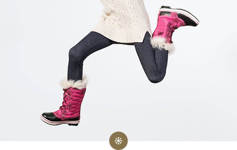 A girl running in snow boots.