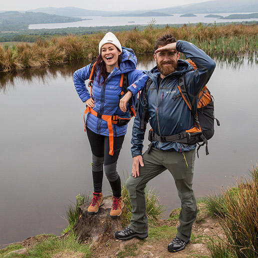 Mamrie Hart and Aldo Kane beside a bog in Scotland.