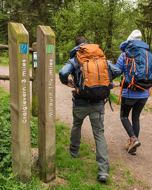 Aldo Kane and Mamrie Hart at a trailhead on the West Highland Way in Scotland.