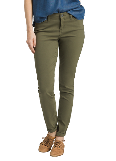 A woman wearing dark green, skinny-leg Stretch Zion pants.