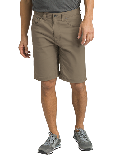 A man wears light grey Stretch Zion shorts with sneakers.