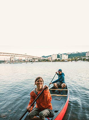 Paddlers in a boat on the Willamette River in Portland, Oregon.