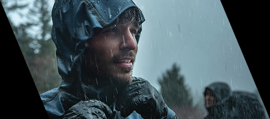 A man wearing an OutDry Extreme Titanium jacket. Close-up of an OutDry Extreme jacket for men.