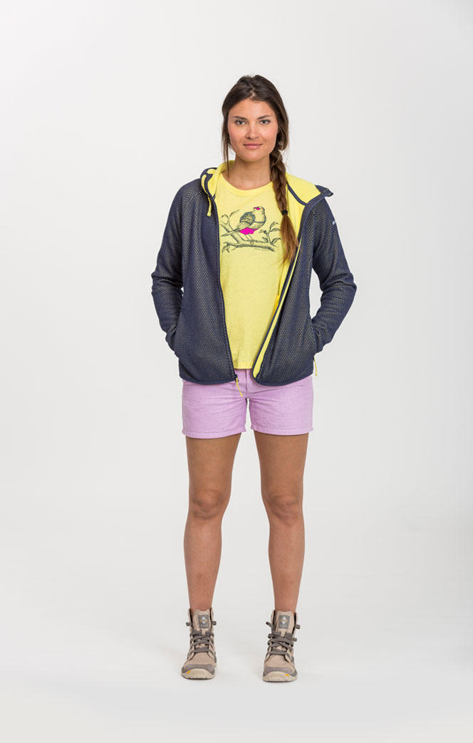 A woman wearing a blue hoodie and a pair of pink shorts