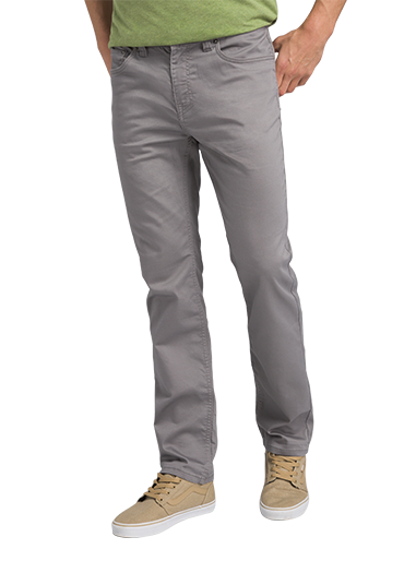 A man wearing light grey outdoor jeans and tan sneakers.
