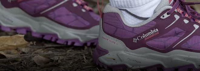 Close-up of the FluidFoam midsole on a pair of purple and grey Columbia Montrail Trans Alps™ II trail running shoes.