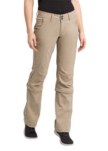 A woman wearing khaki colored Stretch Zion pants that zip off at the knee.
