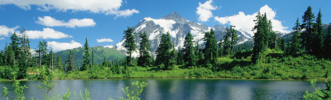 A beautiful lake in a snowy mountain range.