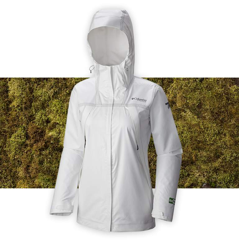 A white OutDry Extreme Eco Tech Shell jacket on a grassy background.