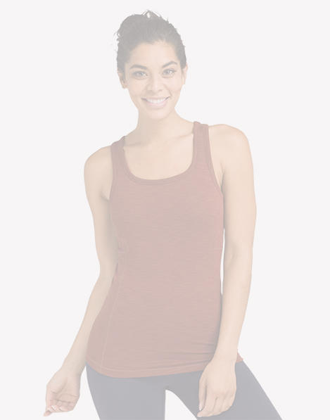 A woman wearing a burnt orange, fitted yoga tank top.