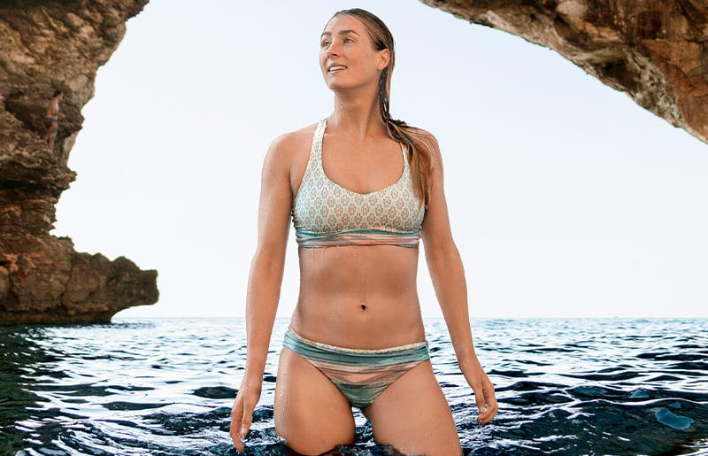 860b1445a45b7 A woman wearing a patterned bikini stands in the sea of Mallorca.