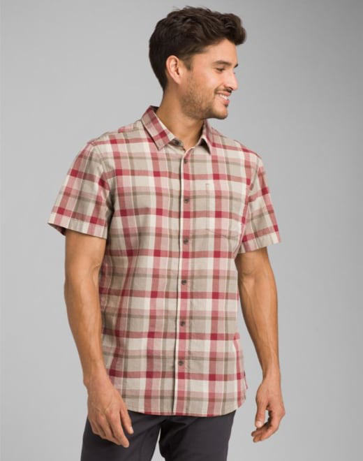 bc8f04989c A man wearing a red, white, and light-brown plaid button-up · Shop Tops