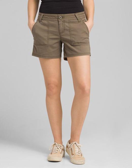 412cf8e416 A woman wearing light-brown shorts.