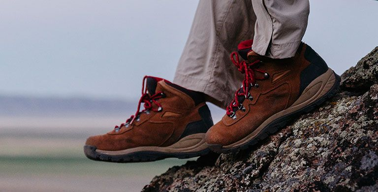 Close-up of a person wearing Columbia hiking boots.
