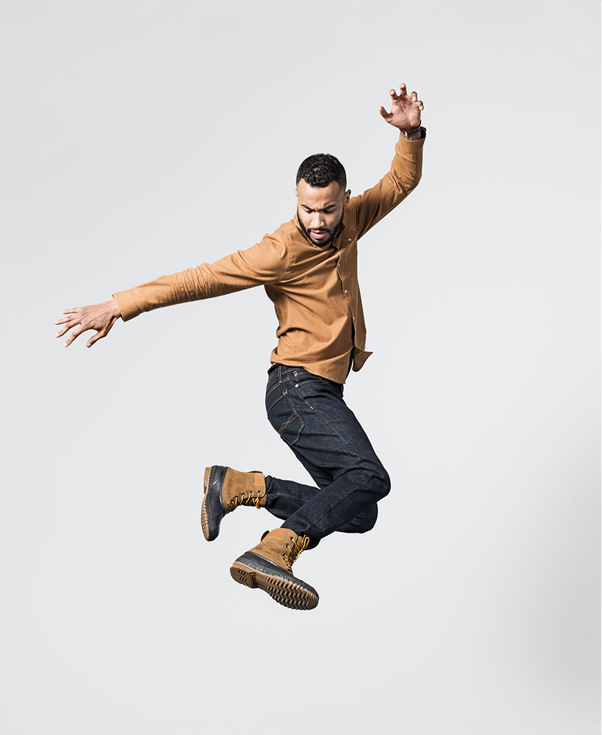 a man jumping with brown boots