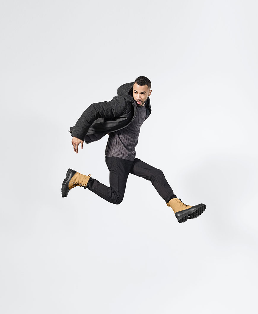 a man jumping wearing brown and black boots