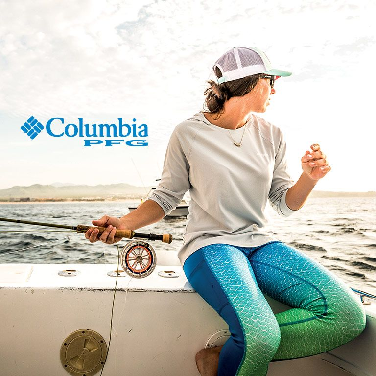 5353dfe57 A woman wearing PFG fishing on a boat.