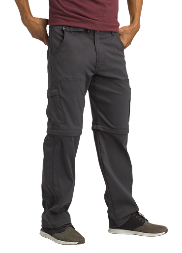A man wears dark grey Stretch Zion pants with zip-off knees.