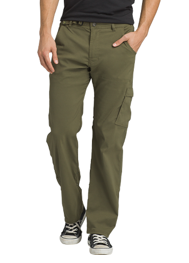 A man wears dark green Stretch Zion pants with cargo pockets.