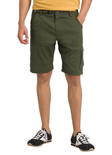 A man wears dark green Stretch Zion shorts with tennis shoes.