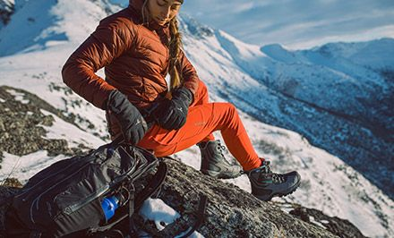 A mountain climber wearing boots with Omni-Heat.