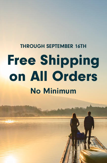 Banner of a man and woman standing at the end of a dock overlooking a lake describes the free shipping promotion.