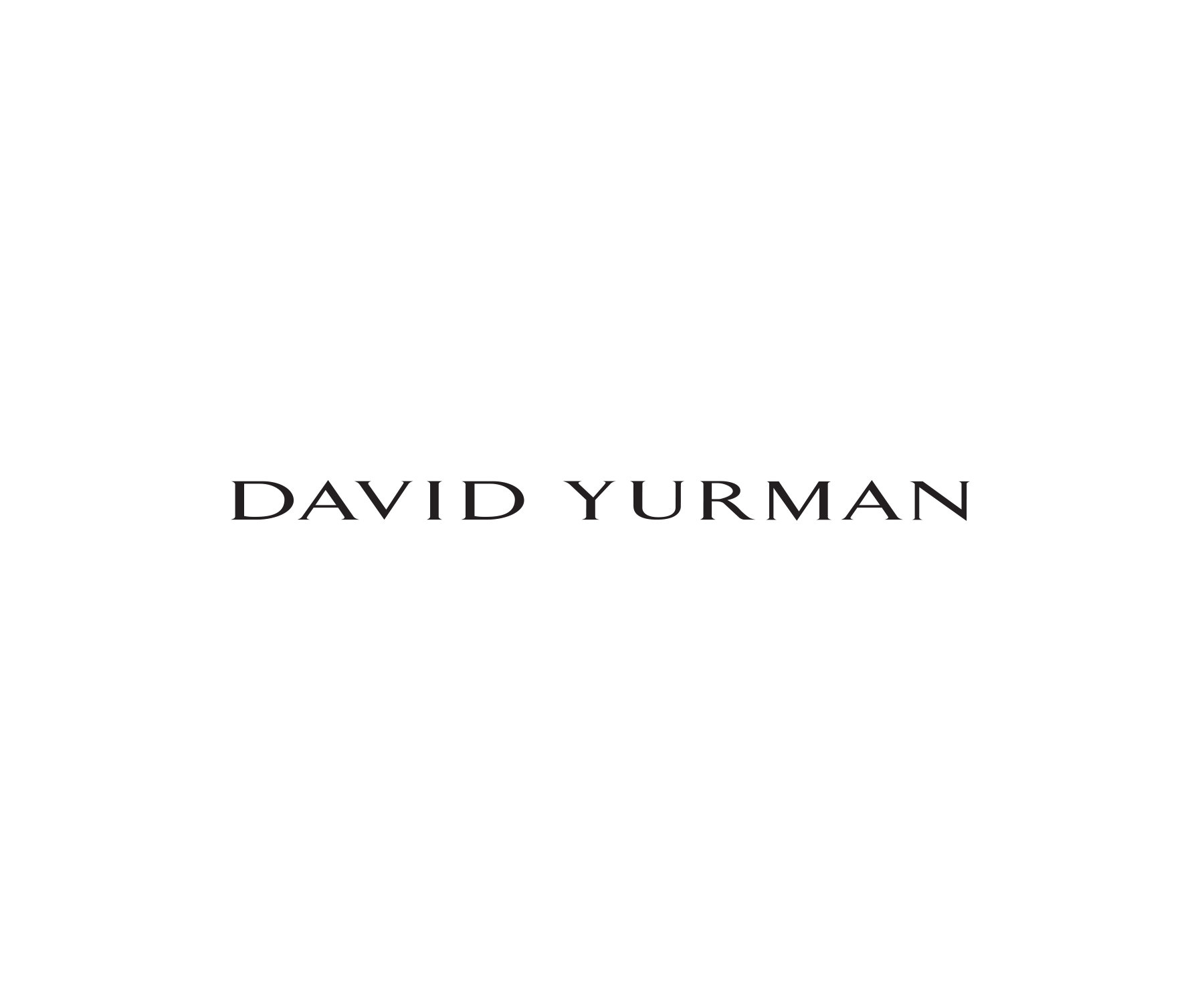 David Yurman Continuance®, Helena and Pearl rings in sterling silver or 18K yellow gold with cultured pearls and white diamonds, arranged in a group casting shadows on a light textured stone.