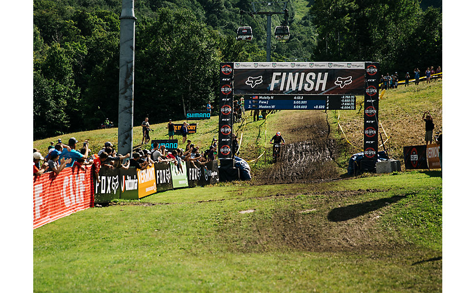 Mountain biker riding through the finish line at the Fox US Open of Mountain Bike