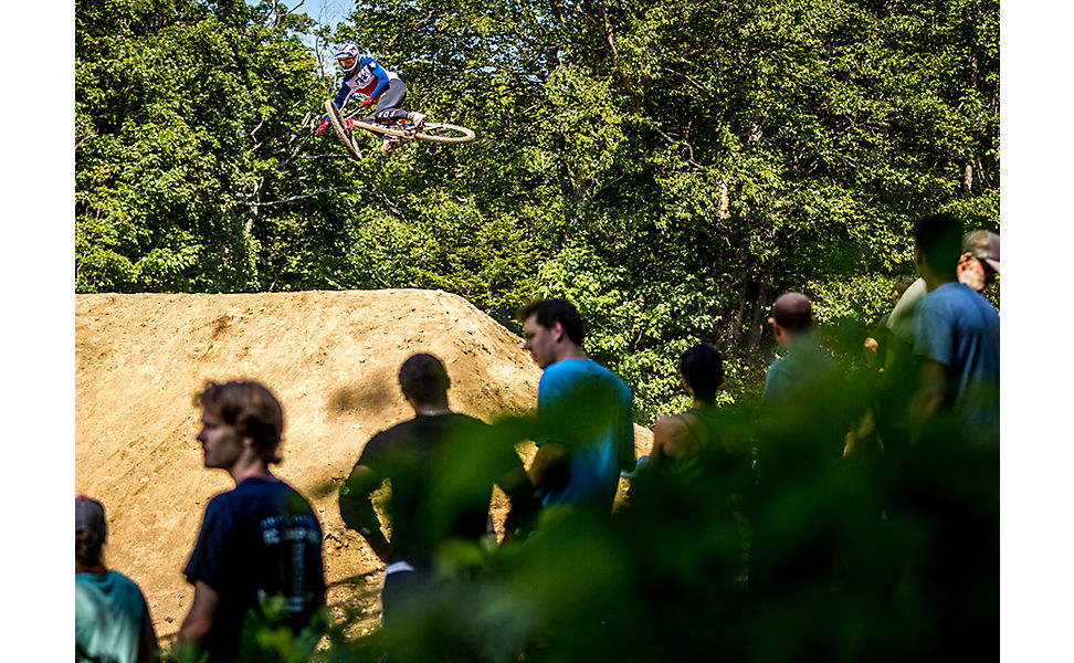 Mountain biker jumping his bike at the Fox US Open of Mountain Bike