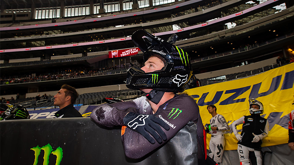 Adam Cianciarulo leading against a railing at the 2020 Arlington Supercross.