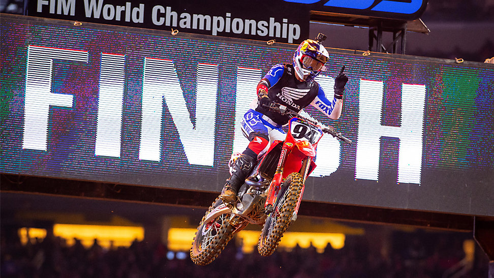 Ken Roczen jumping the finish line jump at race one of the Arlington Supercross Triple Crown. He is signaling first with his finger in celebration of his win.