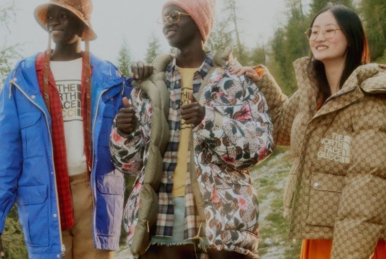 Three models dressed in patterned, outdoors-inspired pieces from the Gucci x The North Face capsule collection