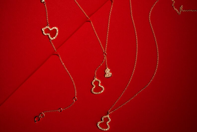 Three fine gold necklaces with diamond pendants
