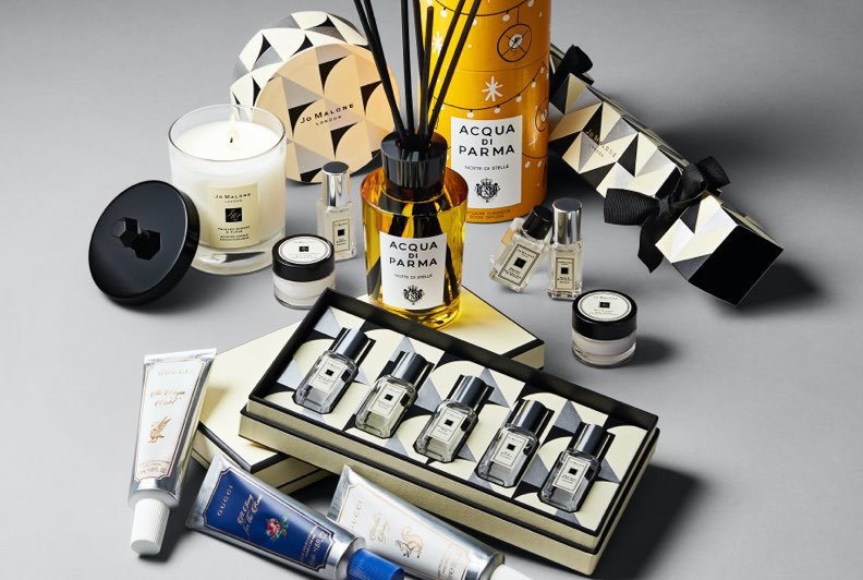 A selection of beauty produts including candles, fragrances, hand creams, and more
