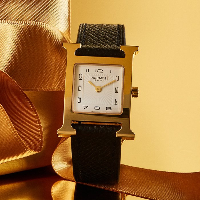 Holt Renfrew image of Day 4. HERMÈS Heure H Gold-Plated Watch. $3300. FIND YOUR STORE