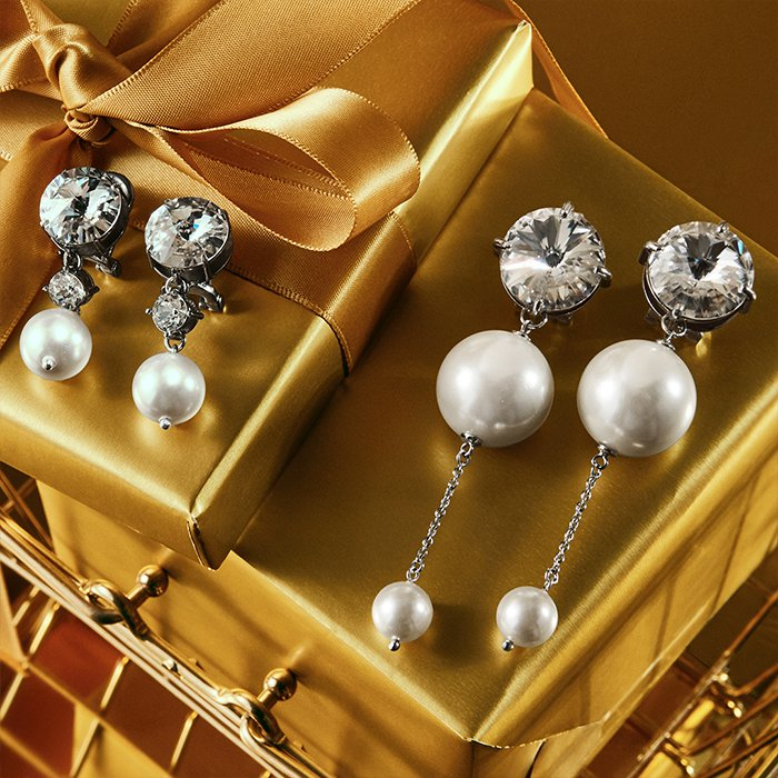 Holt Renfrew image of Day 7. MIU MIU Earrings With Swarovski Crystals and Pearls. $340. Drop Earrings With Swarovski Crystals and Pearls. $460.
