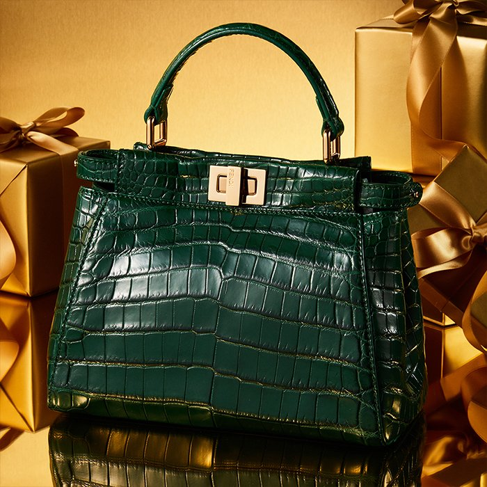 Holt Renfrew image of Day 11. FENDI Crocodile Leather Handbag in Emerald Green. $26,000. LEARN MORE