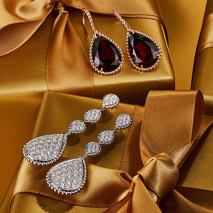 Holt Renfrew image of Day 24. BOUCHERON From the Serpent Bohème Collection. Sleeper Earrings In Pink Gold With Rhodolite Garnet. $25,285. Pendant Earrings In White Gold With Pavé Diamonds. $55,250. LEARN MORE.