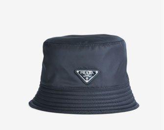 Holt Renfrew image of PRADA. Nylon Bucket Hat. $395. SHOP NOW