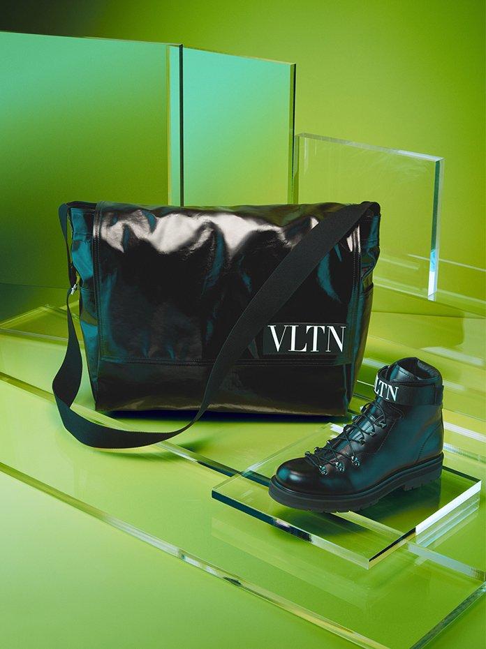 Holt Renfrew Image of VALENTINO nylon messenger bag with VLTN patch. $1720. Cowhide trekking boot with rubberized VLTN logo. $1670. Both in black.